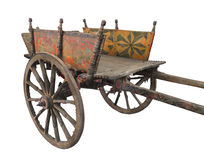 Old wooden two-wheeled cart isolated. Old wooden Sicilian two-wheeled work cart called a carretto, decorated with paintings and carvings.  Isolated on white Royalty Free Stock Images