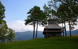 Old wooden Ukrainian Church stands high in the mountains stock images