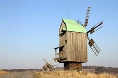 Old wooden Ukrainian mill. Rural landscape. Stock Image