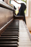 Old wooden upright piano keyboard Royalty Free Stock Photo