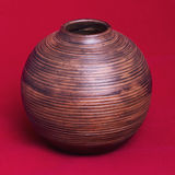 Old Wooden Vase. Old Hand made Wooden Vase on a red background Stock Photos