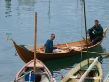 Old wooden Viking boat in Bermeo. Bizkaia. Old handmade Viking wooden boat with two rowers in Bermeo. Bizkaia Stock Image