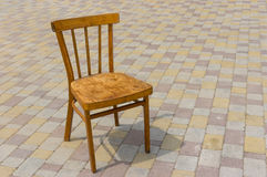 Old wooden vintage chair on a pavement Royalty Free Stock Photo