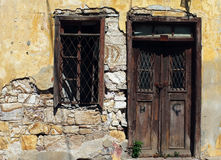 Old wooden vintage door and window in ruin Royalty Free Stock Photography