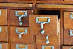 Wooden vintage Medicine drawer cabinet. Catalog file cabinet. Data storage. Old wooden vintage Medicine drawer cabinet. Catalog file cabinet. Data storage royalty free stock photos