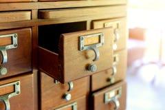 Wooden vintage Medicine drawer cabinet. Catalog file cabinet. Data storage. Old wooden vintage Medicine drawer cabinet. Catalog file cabinet. Data storage stock photos