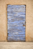 Old wooden violet color door Stock Photos