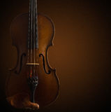 Old wooden violin on dark brown Stock Images