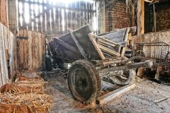 Old wooden waggon. Standing in an old barn Royalty Free Stock Image