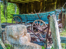 Old Wooden Wagon. Bales of hay and an old wooden wagon in this barn in Millbrook Village in Northern New Jersey Stock Photos