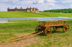 Old wooden wagon on old castle backgrounds Stock Photo