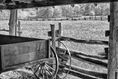 Old wooden wagon. Parked in the barn Royalty Free Stock Images