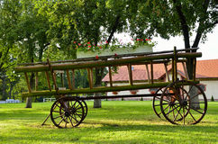 Old wooden wagon in the park decoration Royalty Free Stock Photography