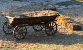 Old wooden wagon with straw Stock Images