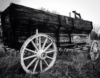 Old wooden wagon. An up close black and white photo of an antique wooden wagon in a field stock photos