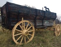 Old wooden wagon. An up close photo of an antique wooden wagon in a field stock image