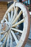 Old wooden wagon wheel. The old wooden wagon wheel Stock Image