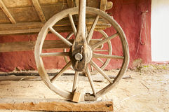 Old wooden wagon. Wheel in an old barn Royalty Free Stock Photo