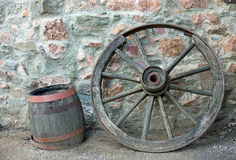 Old wooden wagon wheel and barrel Stock Photo