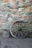 Old wooden wagon wheel and barrel Royalty Free Stock Photography