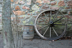 Old wooden wagon wheel and barrel Royalty Free Stock Image