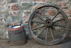 Old wooden wagon wheel and barrel Stock Photos