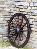 Old wooden wagon wheel. Brown Stock Photography