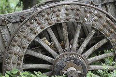 Old Wooden Wagon Wheel. Old wooden wagon in the details Stock Photo