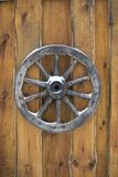 Old wooden wagon wheel hanging. On the wall Royalty Free Stock Image