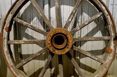 Old wooden wagon wheel with hub and spokes Stock Images