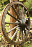 Old wooden wagon wheel. Old wheel made in wood and iron Stock Photos