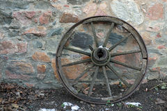 Old wooden wagon wheel Stock Photos