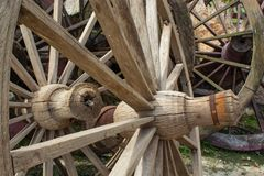 The old wooden wagon wheels. In park Stock Photography