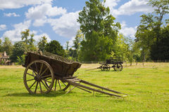 Old wooden wagons in the meadows Stock Photo