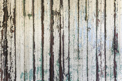 Old wooden wall. Old aged shabby wooden wall with old white flaky paint peeling off Royalty Free Stock Images
