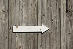 Old wooden wall with arrow sign Royalty Free Stock Photo