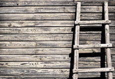 Old wooden wall background with ladder Stock Photos