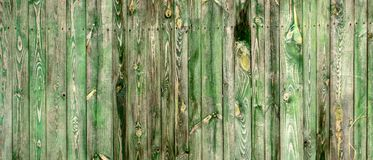 The old wooden walls painted green. Old wooden wall background or texture. Old wooden wall background or texture The old wooden walls painted green royalty free stock photography