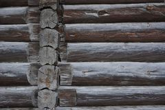 Old wooden wall of blockhouse. Facade of a log house built at the end of 19th century without nails in Russia.  royalty free stock photos