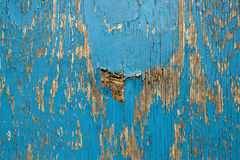 Old wooden wall with blue paint pealing off Stock Images