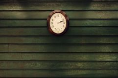 Old wooden wall with clock Royalty Free Stock Photo