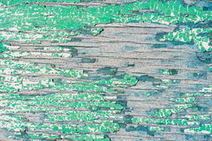 Old wooden wall with cracked and peeling green paint Royalty Free Stock Photography