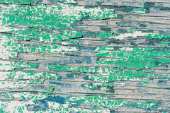 Old wooden wall with cracked and peeling green paint Royalty Free Stock Image