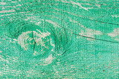 Old wooden wall with cracked and peeling green paint Stock Photos