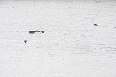 Old wooden wall with cracked and peeling white paint Stock Images