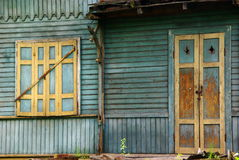 Old wooden wall with exterior shutters and door. Old wooden wall with exterior shutters, door and roof, Otwock County, Poland Stock Photo