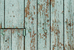 Old wooden wall with green paint peeling off Stock Photography