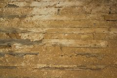 Old wooden wall with insulation made of clay. Royalty Free Stock Photography