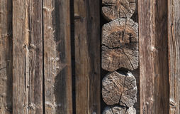 Old wooden wall made of brown logs Royalty Free Stock Photo