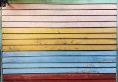 Old Wooden Wall Made Of Colorful Planks stock image